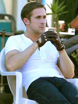 Ryan Gosling wearing leather driving gloves in the movie Drive